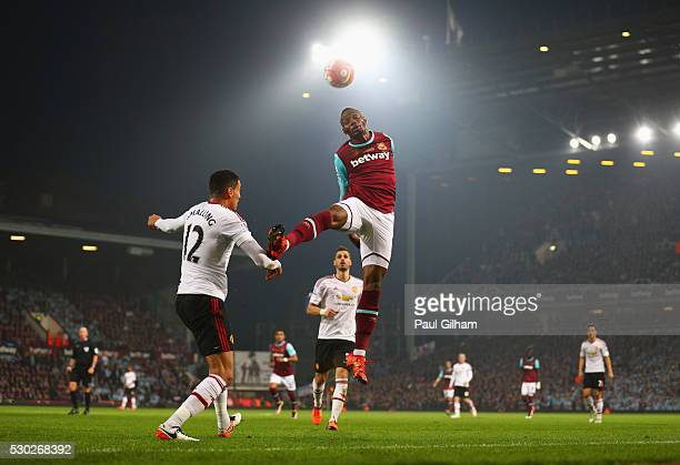 Diafra Sakho of West Ham United and Chris Smalling of Manchester United battle for the ball during the Barclays Premier League match between West Ham...