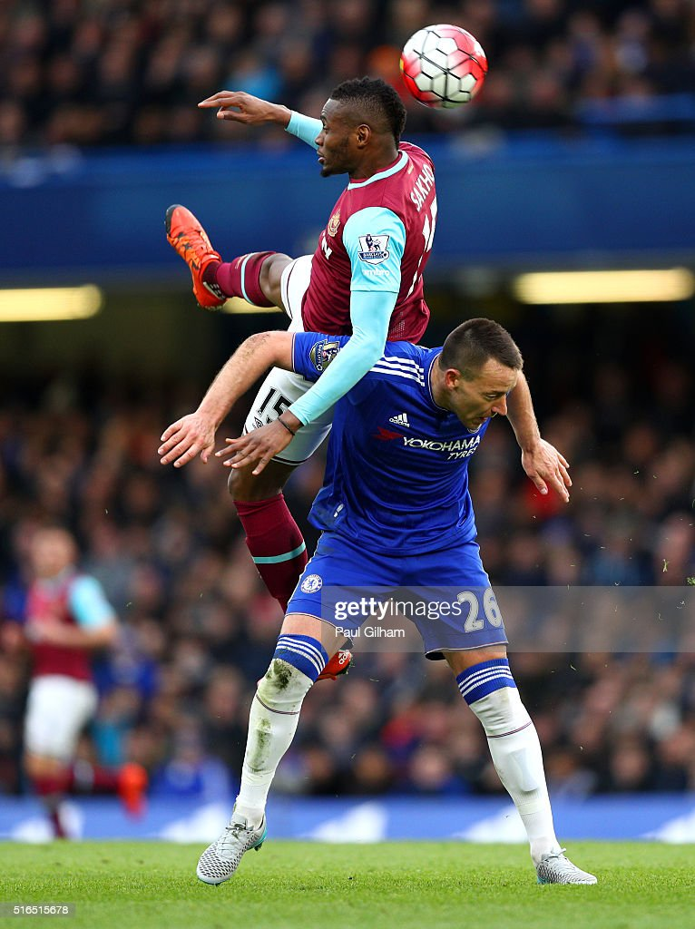 Diafra Sakho of West Ham United and John Terry of Chelsea compete for the ball during the Barclays Premier League match between Chelsea and West Ham United at Stamford Bridge on March 19, 2016 in London, United Kingdom.