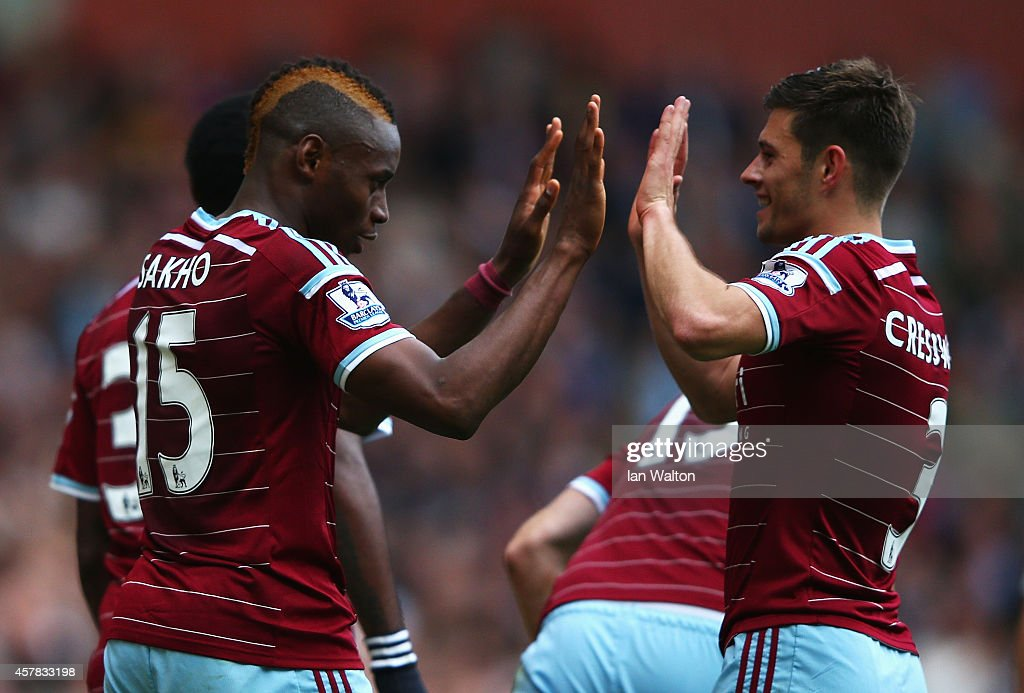 Diafra Sakho (L) of West Ham United celebrates scoring his team's second goal with Aaron Cresswell of West Ham United during the Barclays Premier League match between West Ham United and Manchester City at Boleyn Ground on October 25, 2014 in London, England.