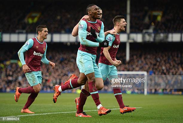 Diafra Sakho of West Ham United celebrates scoring his team's second goal with his team mates during the Barclays Premier League match between...
