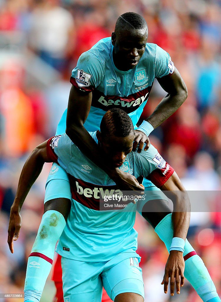 Diafra Sakho (bottom) of West Ham United celebrates scoring his team's third goal with his team mate Cheikhou Kouyate (top)during the Barclays Premier League match between Liverpool and West Ham United at Anfield on August 29, 2015 in Liverpool, England.