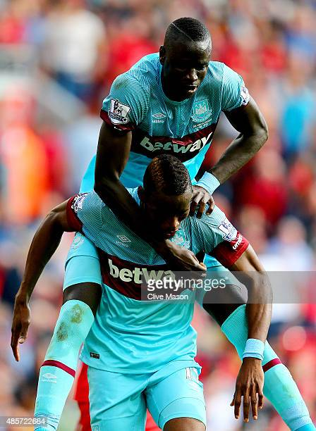 Diafra Sakho of West Ham United celebrates scoring his team's third goal with his team mate Cheikhou Kouyate during the Barclays Premier League match...
