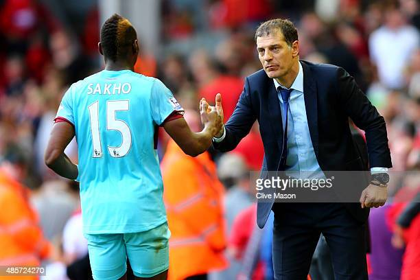 Diafra Sakho of West Ham United celebrates scoring his team's third goal with manager Slaven Bilic during the Barclays Premier League match between...