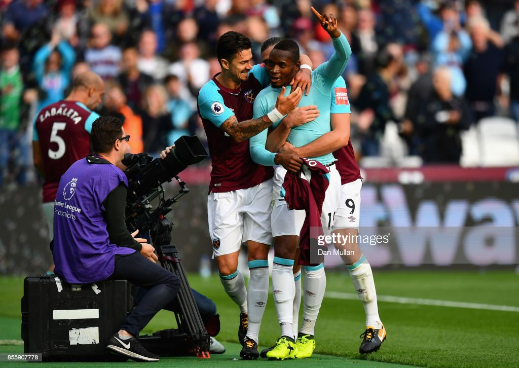 Diafra Sakho (2nd R) of West Ham United celebrates scoring the opening goal with his team mates during the Premier League match between West Ham United and Swansea City at London Stadium on September 30, 2017 in London, England.