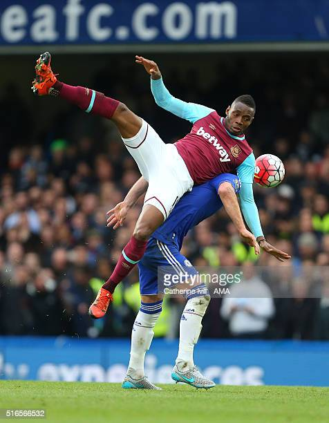 Diafra Sakho of West Ham United goes over the top of John Terry of Chelsea during the Barclays Premier League match between Chelsea and West Ham...