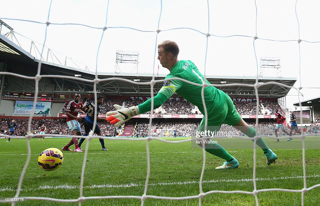 Diafra Sakho of West Ham United heads his team's second goal past Joe Hart of Manchester City during the Barclays Premier League match between West Ham United and Manchester City at Boleyn Ground on October 25, 2014 in London, England.