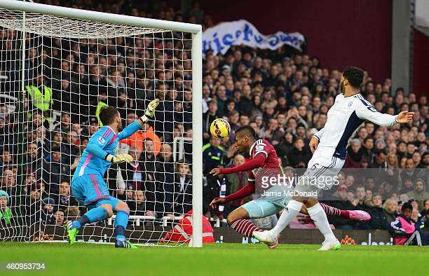 Diafra Sakho of West Ham United heads the ball past goalkeeper Ben Foster of West Bromwich Albion to score their first goal during the Barclays...