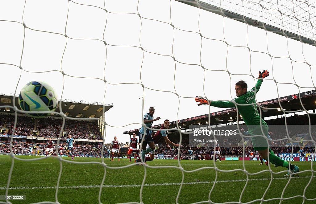 Diafra Sakho of West Ham United heads the opening goal past Tom Heaton of Burnley during the Barclays Premier League match between Burnley and West Ham United at Turf Moor on October 18, 2014 in Burnley, England.