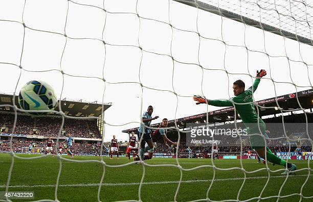 Diafra Sakho of West Ham United heads the opening goal past Tom Heaton of Burnley during the Barclays Premier League match between Burnley and West...