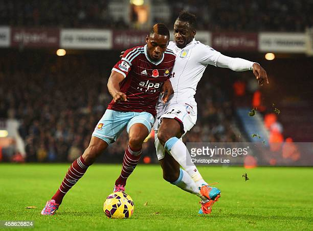 Diafra Sakho of West Ham United is tackled by Aly Cissokho of Aston Villa during the Barclays Premier League match between West Ham United and Aston...