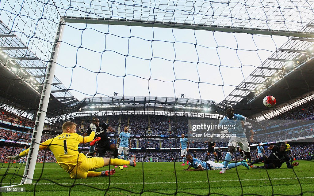 Diafra Sakho of West Ham United scores his team's second goal past Joe Hart of Manchester City during the Barclays Premier League match between Manchester City and West Ham United at Etihad Stadium on September 19, 2015 in Manchester, United Kingdom.