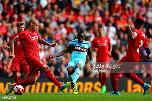 Diafra Sakho of West Ham United scores his team's third goal during the Barclays Premier League match between Liverpool and West Ham United at...