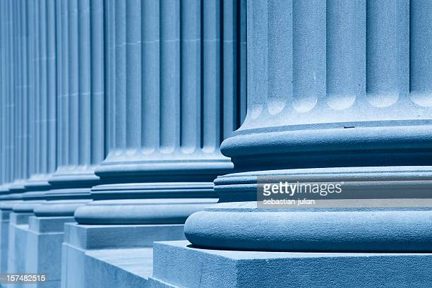 Diagonal view of large blue columns