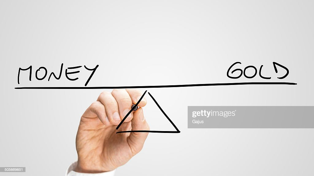 Diagram Of A Seesaw Showing Money And Gold Stock Photo Getty Images
