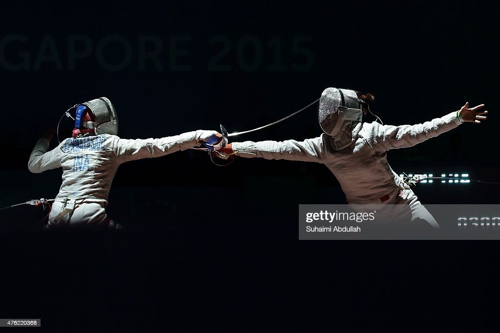 Diah Permatasari of Indonesia (L) fights Sirawalai Starrat of Thailand (R) in the women's fencing team sabre semifinals at the OCBC Arena Hall during the 2015 SEA Games on June 7, 2015 in Singapore.