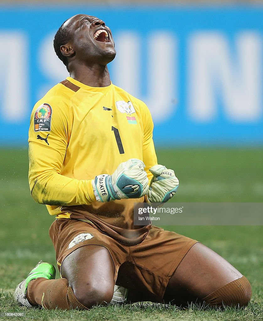 Diakite Daouda of Burkina Faso celebrates after saving a penalty during the 2013 Africa Cup of Nations Semi-Final match between Burkina Faso and Ghana at the Mbombela Stadium on February 6, 2013 in Nelspruit, South Africa.