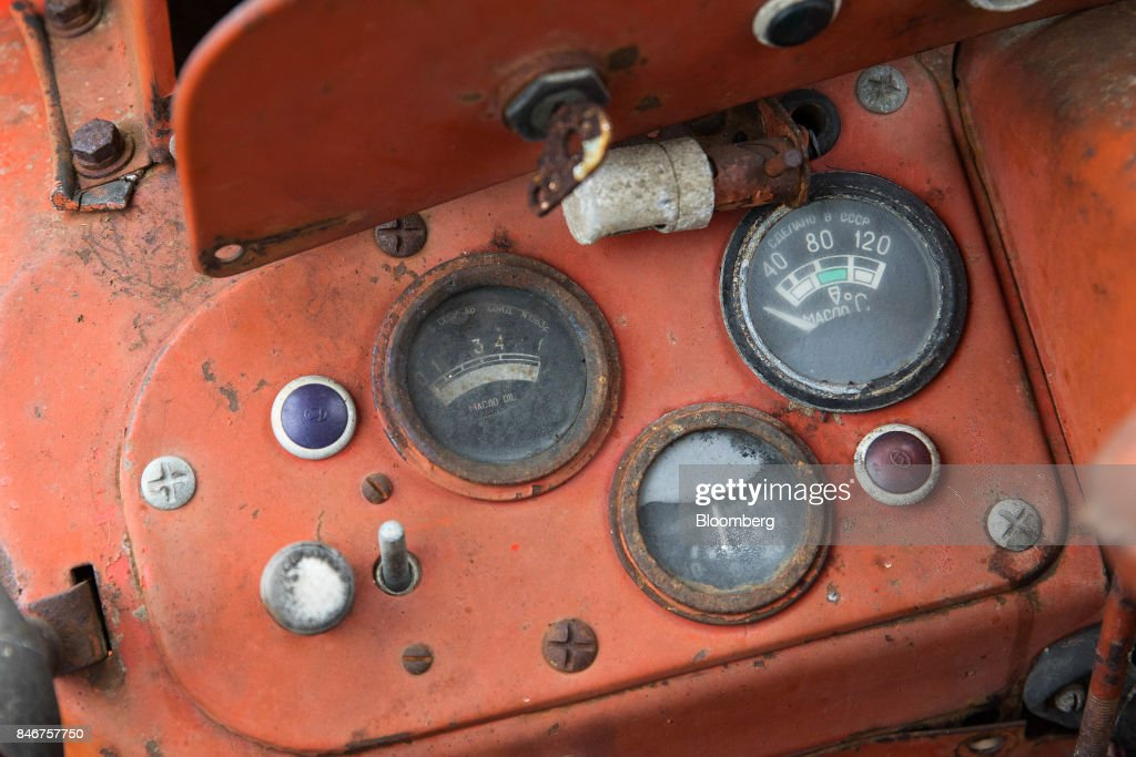 Dials sit on the dashboard of a tractor, manufactured by Massey Ferguson Corp., at the Cheffins Cambridge Machinery Sales monthly machinery and plant auction in Sutton, U.K., on Monday, Sept. 4, 2017. The debate over food andfarmingpolicy after Brexit has heated up recently, with Environment Secretary Michael Gove telling BBC Radio 4 that the U.K wouldnt lower its animal welfare or environmental standards to achieve any new trade deals. Photographer: Simon Dawson/Bloomberg via Getty Images
