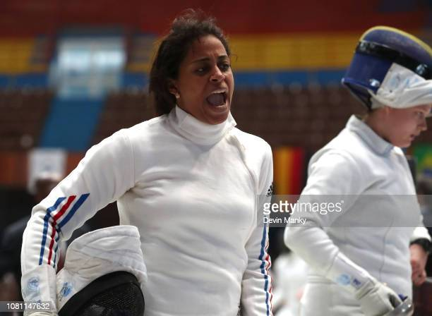 Diamelys Gonzalez Sandoval of Cuba celebrates a win over Adela Danciu of Romania during the preliminary rounds at the Women's Epee World Cup on...