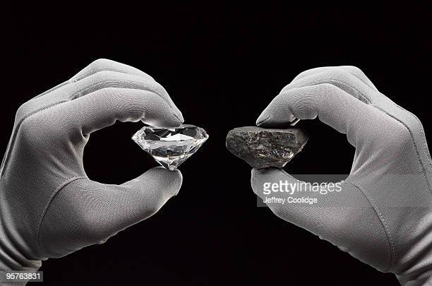 Diamond and Coal in Gloved Hands