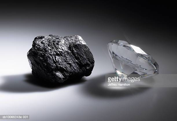 diamond and piece of coal - comparison stock pictures, royalty-free photos & images