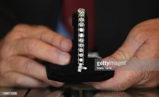 A diamond bracelet is displayed at a press preview of an auction of 400 pieces of personal property jewelry and antiques from Bernard and Ruth Madoff...