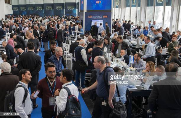 Diamond buyers and sellers attend the International Diamond Week in the Israeli city of Ramat Gan east of Tel Aviv on February 14 2017 Some 400...