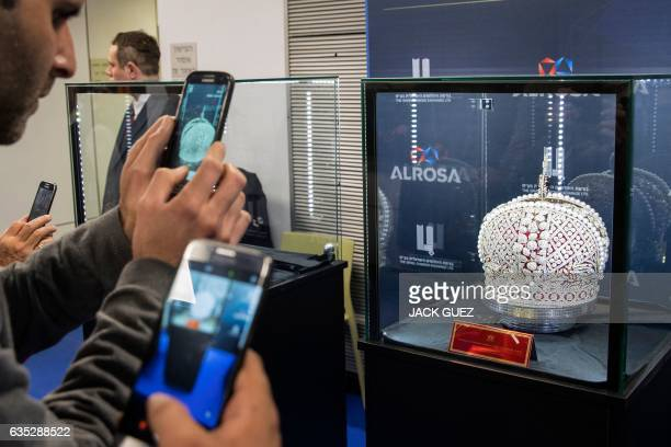 Diamond buyers take a picture of a replica of Russian Queen Catherine the Great's imperial crown which was used in the coronations of all Russian...
