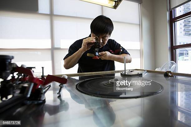 A diamond cutter polishes a Canadian diamond at the NWT Diamond Centre in Yellowknife Northwest Territories Canada on Tuesday May 3 2016 The price...