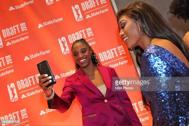 Diamond DeShields poses for a selfie with Victoria Vivians on the orange carpet prior to the 2018 WNBA Draft 2018 on April 12 2018 at Nike New York...