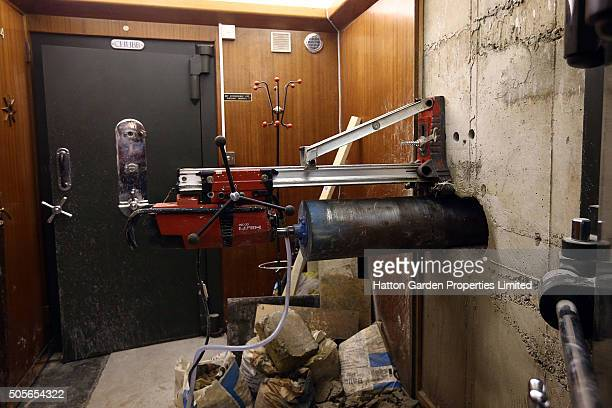 Diamond drill is positioned to drill a hole in the wall used by burglars to access the underground vault of the Hatton Garden Safe Deposit Company...