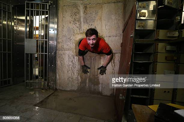 Diamond driller Sunny Kirby climbs through the hole used by burglars to access the underground vault of the Hatton Garden Safe Deposit Company which...