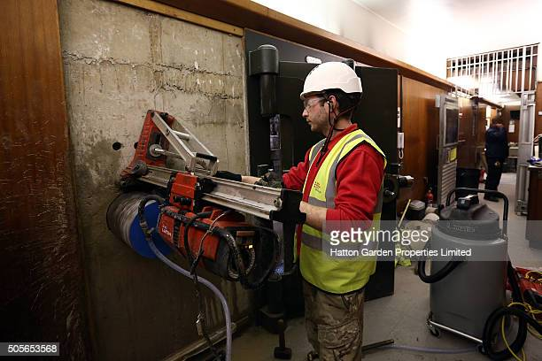 Diamond driller Sunny Kirby drills a hole in the wall used by burglars to access the underground vault of the Hatton Garden Safe Deposit Company...