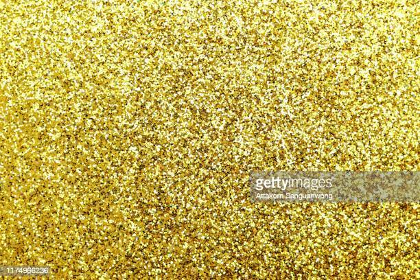 diamond dust gold as background - glitter stock pictures, royalty-free photos & images