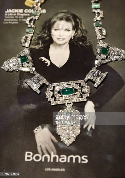 Diamond, emerald, stone and platinum necklace with an estimate of US$40,000 to US$60,000 from Jackie Collins' private collection goes on display at a...