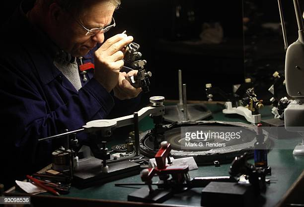 A diamond grinder uses a grinder machine to polish diamonds at the Diamond Museum on November 09 2009 in Antwerp Belgium Expo 'Let's Talk Stones'...