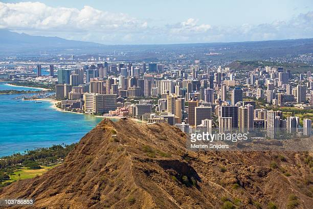diamond head crater and honolulu shore with skyline. - merten snijders stock pictures, royalty-free photos & images