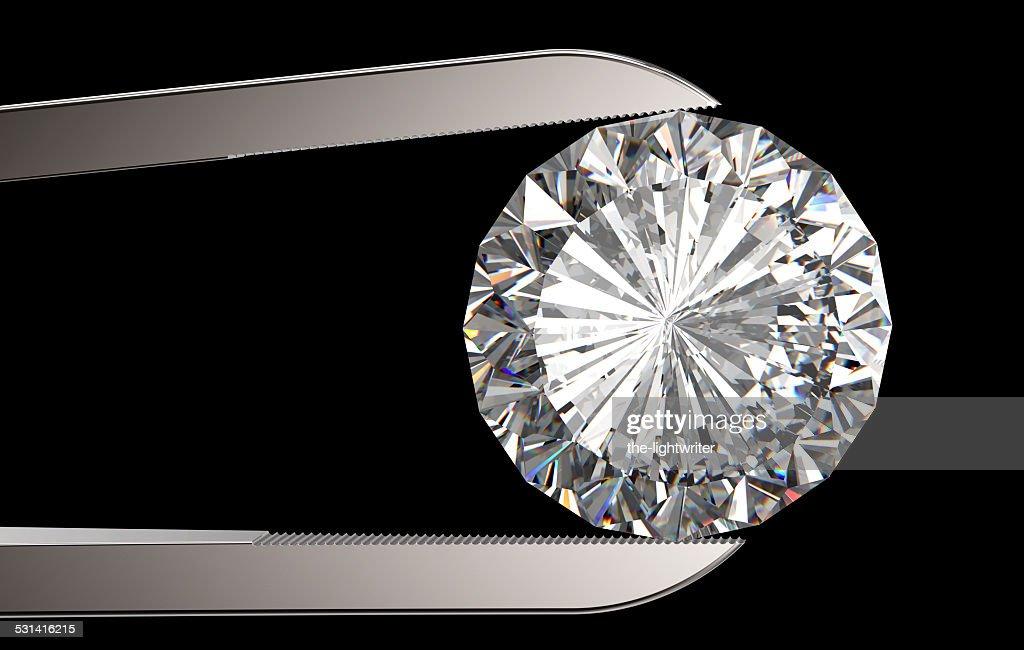 Diamond in tweezers : Stock Photo