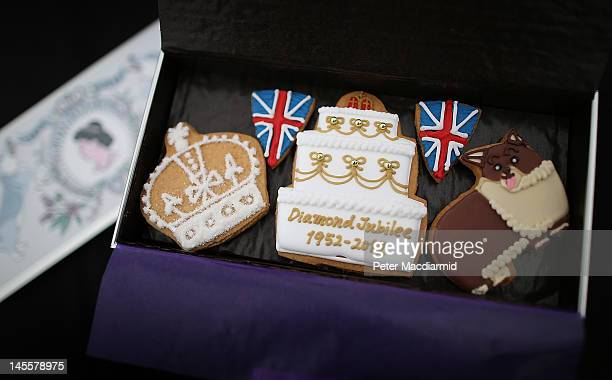 Diamond Jubilee themed biscuits are given out ahead of The Derby on June 2 2012 in Epsom England For only the second time in its history the UK...
