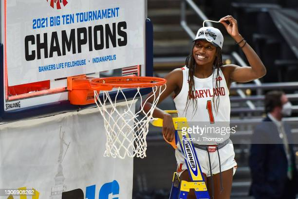 Diamond Miller of the Maryland Terrapins women's basketball team cuts down a piece of the net after beating the Iowa Hawkeyes in the finals of the...