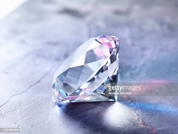 diamond on piece of granite, close-up - stone object stock pictures, royalty-free photos & images