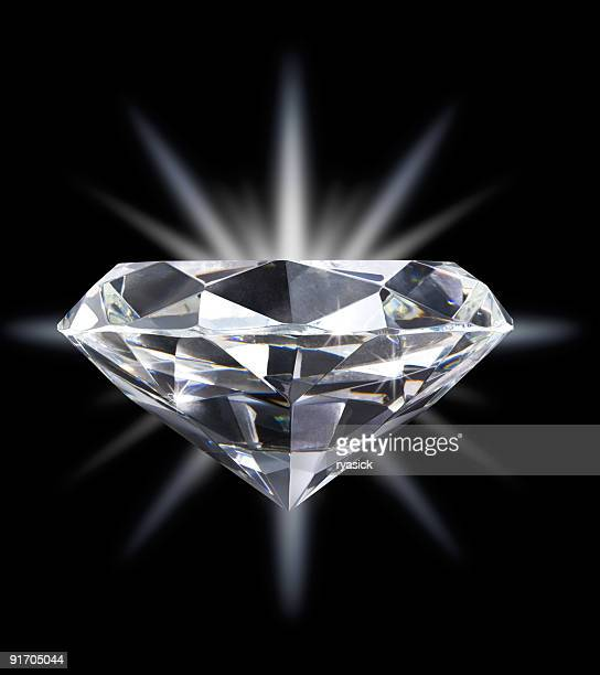 Diamond Over Star Burst Background Isolated on Black