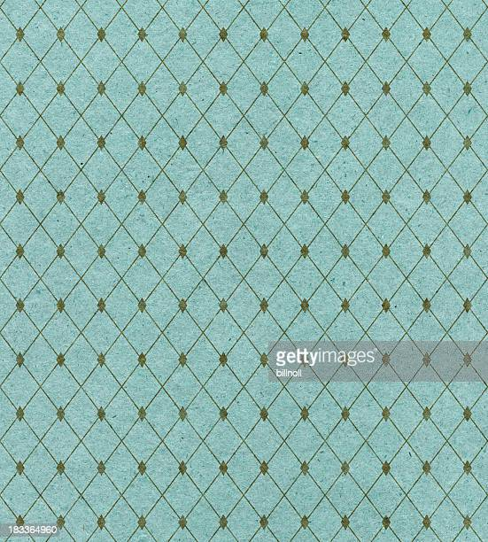 A diamond pattern covers turquoise wallpaper