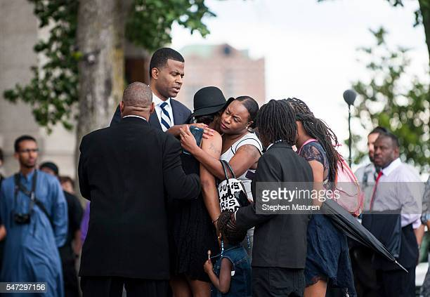 Diamond Reynolds center wearing black hat cries outside the funeral of Philando Castile at the Cathedral of St Paul on July 14 2016 in St Paul...