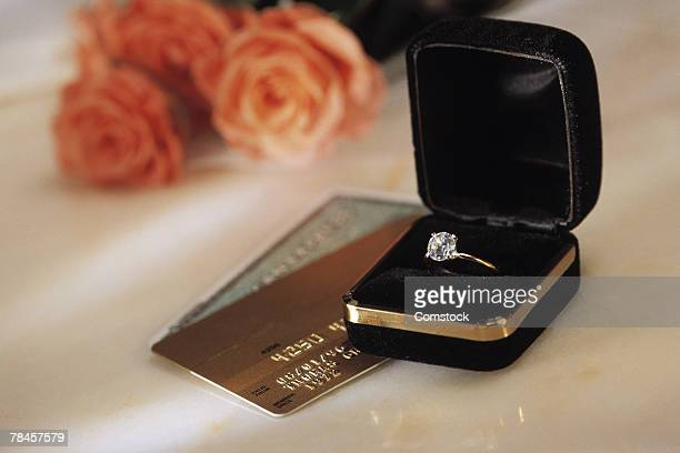 Diamond ring and credit cards symbolize wedding expenses