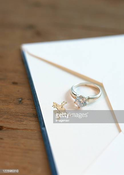 Diamond ring and envelope