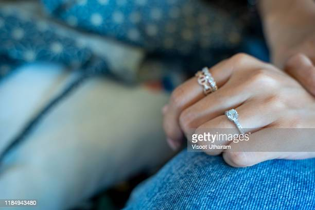diamond ring on the woman's finger. - skin diamond stock pictures, royalty-free photos & images