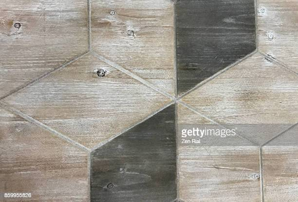 Diamond shape patterns on a wooden table top