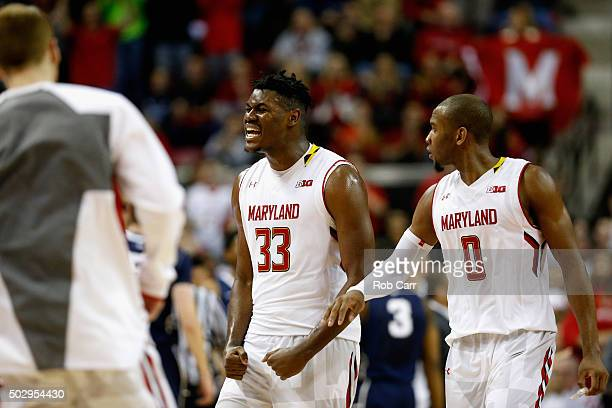 Diamond Stone of the Maryland Terrapins and Rasheed Sulaimon celebrate during a timeout late in the second half of Maryland's 7064 win over the Penn...