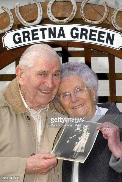 Diamond wedding couple Ronald Woodard 84 and Muriel Woodard 83 with a photograph from their wedding day in 1956 at Gretna Green Wednesday April 5...