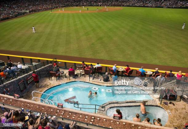 Diamondback fans enjoy the outfield pool during the Halos' 71 victory over the Diamondbacks at Chase Field Thursday INFO angels0619kjs Photo by KEVIN...